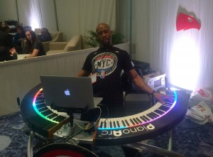 Sir Foster, Atlanta Hawks in stadium artist, driving the PianoArc DualWing at NAMM 2016
